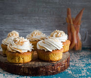 Carrot muffins with cream Stock Photography