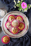 Carrot muffins with  icing sugar and flowers Stock Photos