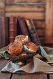 Carrot muffins with maple syrup. On rustic background royalty free stock photography