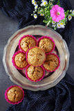 Carrot muffins and summer flowers Stock Photos
