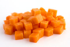 Carrot neatly chopped into cubes Royalty Free Stock Photos