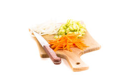 Carrot, onion and celery on a cutting board Royalty Free Stock Image
