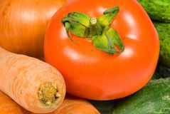 Carrot, onion, cucumber and tomato Stock Images