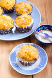Carrot and orange cupcakes. With icing Royalty Free Stock Photos