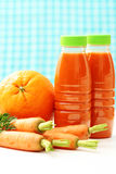 Carrot and orange juice. Bottle of carrot and orange juice with fresh fruits - food and drink Royalty Free Stock Photo