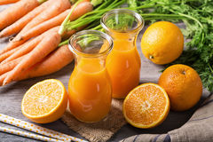 Carrot orange juice. On wooden background Royalty Free Stock Photo
