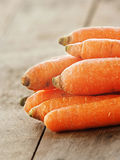 Carrot over wooden background Royalty Free Stock Images