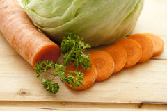 Carrot with parsley. On edge board Royalty Free Stock Image