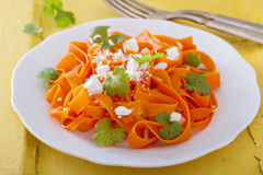 Carrot pasta salad with feta. And almonds Royalty Free Stock Image