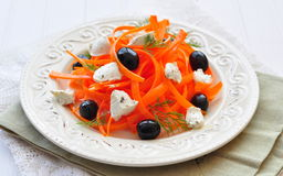 Carrot pasta salad with feta, olivs and dill Royalty Free Stock Photography