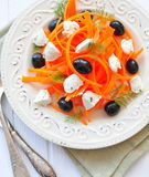 Carrot pasta salad with feta, olivs and dill Stock Photo