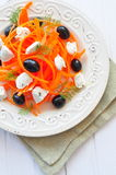 Carrot pasta salad with feta, olivs and dill Stock Image