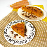 Carrot pie. Carrot and raisin pie with carrots in the background royalty free stock photography