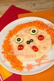 Carrot pizza face Stock Image