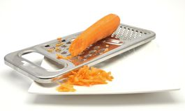 Carrot rasping Stock Images