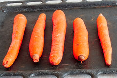 Carrot. Raw carrots on a black background Royalty Free Stock Photos