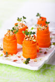 Carrot Roll-Ups. Raw Carrot Roll-Ups with hummus and sprouts for holiday Stock Photos