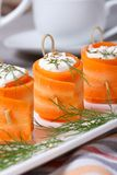 Carrot rolls stuffed with feta cheese. Vertical Royalty Free Stock Image
