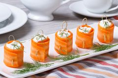 Carrot rolls stuffed with soft cheese close-up Stock Image
