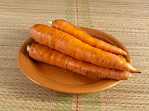 Carrot root on a plate Stock Photos