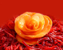 Carrot rose over red. Red beet and carrot with carrot rose over red Royalty Free Stock Image