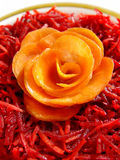 Carrot rose on the salad. Carrot rose and shredded carrot with red beet Royalty Free Stock Photos