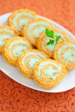 Carrot roulade. Savory carrot roll with cream cheese and parsley, selective focus Royalty Free Stock Photography