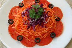 Carrot Salad. With red cabbage, tomatoes, and black olives Stock Photos