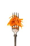 Carrot salad on fork, isolated Royalty Free Stock Images