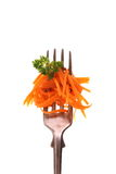 Carrot salad on fork with parsley, isolated Royalty Free Stock Images