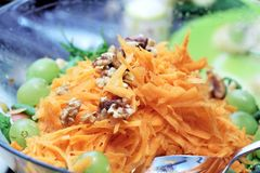 Carrot salad with nuts and grapes Royalty Free Stock Image