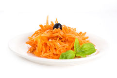 Carrot salad with pine nuts Stock Images