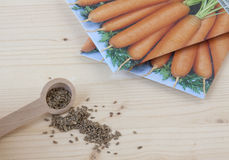 Carrot Seeds. On a wooden background Stock Photos