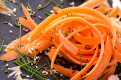 Carrot shavings with several sesame and flux seeds around Royalty Free Stock Photography