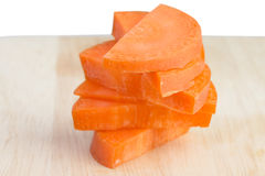 Carrot slice on cutting board Royalty Free Stock Photos
