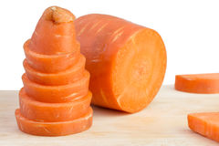 Carrot slice on cutting board Stock Photography