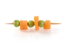 Carrot slices and peas Stock Photos