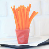 Carrot slices in a red glass Royalty Free Stock Photography