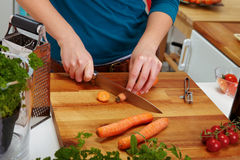 Carrot slicing on cutting board Royalty Free Stock Images