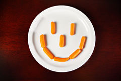 Carrot smile Stock Images