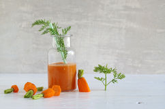 Carrot-smoothie with banana, ginger and chia seeds Stock Image