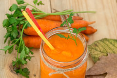Carrot smoothie in a glass jar and vegetables. Healthy eating. Royalty Free Stock Images