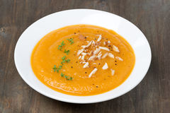 Carrot soup with almonds and cress salad Royalty Free Stock Images