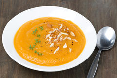 Carrot soup with almonds and cress salad, close-up Stock Image