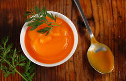 Carrot soup in the bowl Stock Images