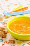 Carrot soup for children with crackers Stock Images