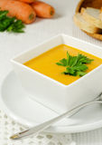 Carrot soup. With ginger and parsley in white bowl Stock Images