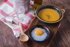 Carrot soup with onsen egg Royalty Free Stock Photos