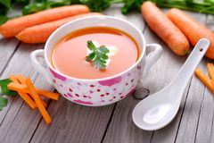 Carrot soup in a porcelain bowl. Royalty Free Stock Photo
