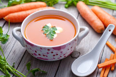 Carrot  soup in a porcelain bowl. Royalty Free Stock Photography
